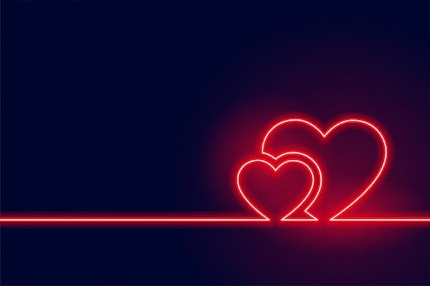 輝く赤いネオンハートバレンタイン当日の背景