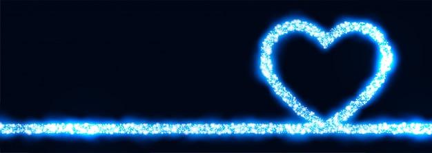 Светящееся синее сердце из сверкающего баннера