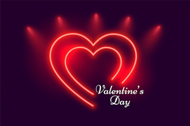 輝く赤いネオンハートバレンタインの日グリーティングカード