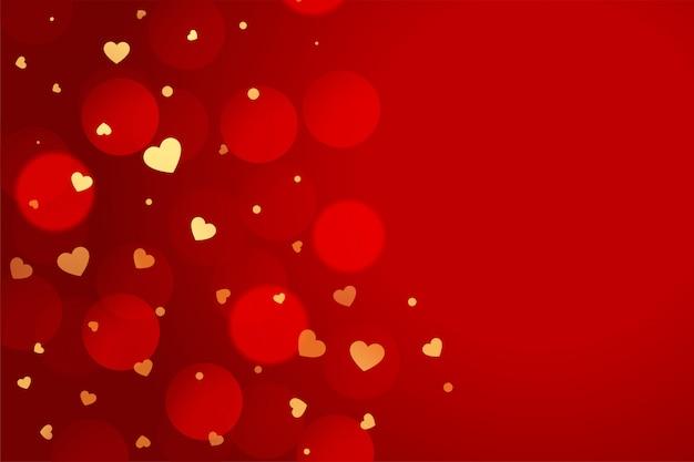 黄金の心を持つ美しい赤いバレンタインデーの背景