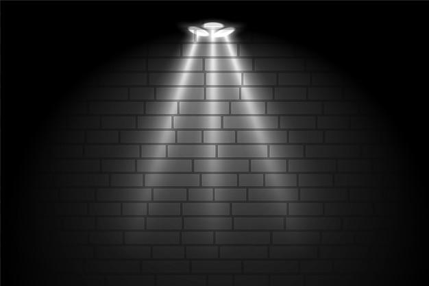 フォーカススポットライトの背景を持つギャラリーの黒い壁