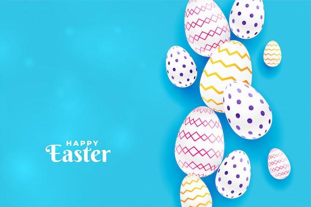 青色の背景にカラフルなイースターパターン卵