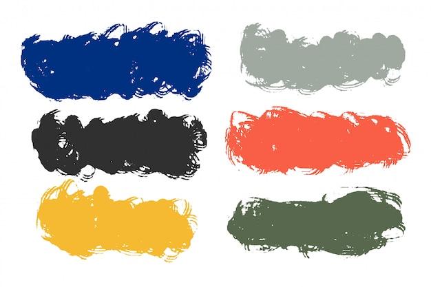 多くの色で抽象的な汚れたグランジ汚れセット