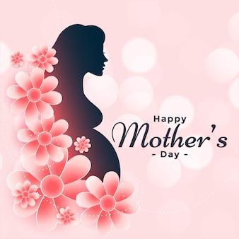 幸せな母の日のための花を持つ妊娠中の女性