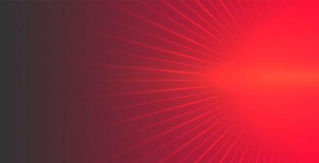 出てくる輝く光線と赤の背景