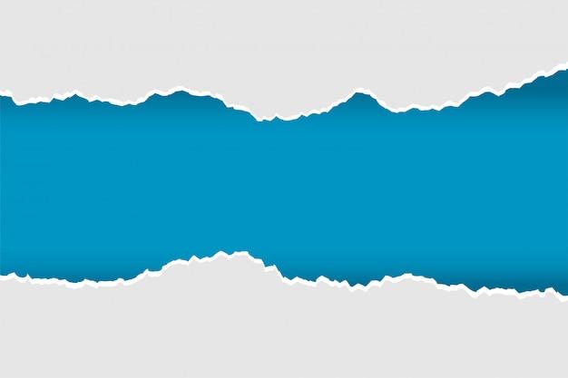 青とグレーの色で引き裂かれた現実的な破れた紙