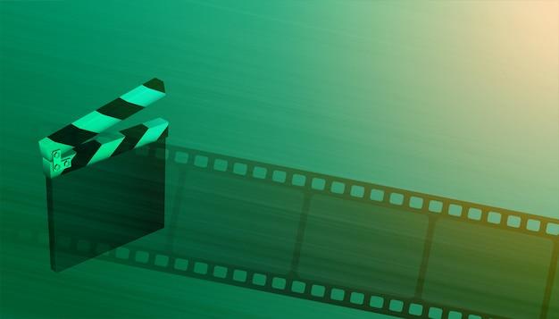 フィルムリールの映画の映画の背景を持つクラッパーボード