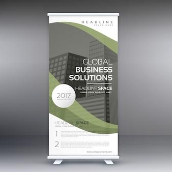エレガントな緑の波状のビジネス立ち客ロールアップバナーデザインテンプレート