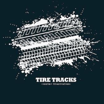 暗い背景に抽象的なグレータイヤのトラックマーク