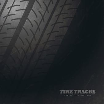 暗い背景とタイヤのトラックマーク