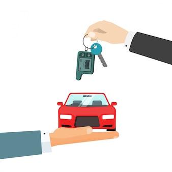 車と車のキーを与える手
