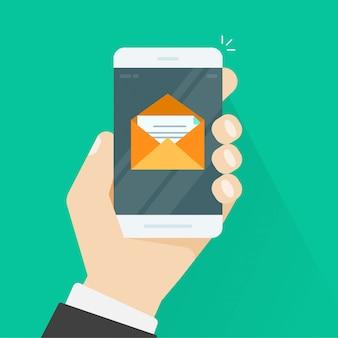 携帯電話と封筒の中の電子メールメッセージ
