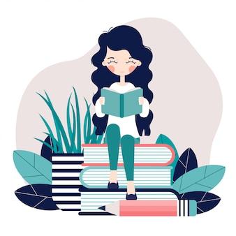 女の子が座って本を読んでいます。