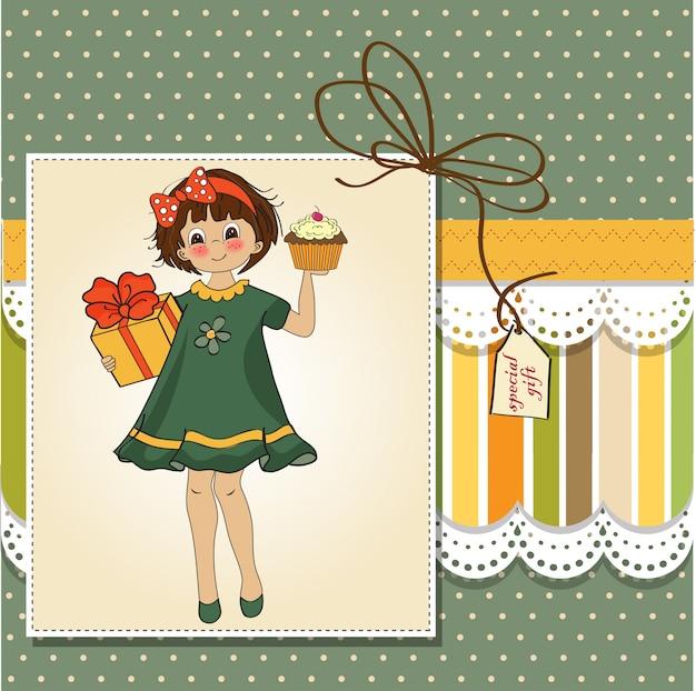女の子と大きなカップケーキと誕生日の挨拶カード