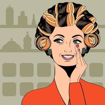 自分の髪でカーラーを持つ女性