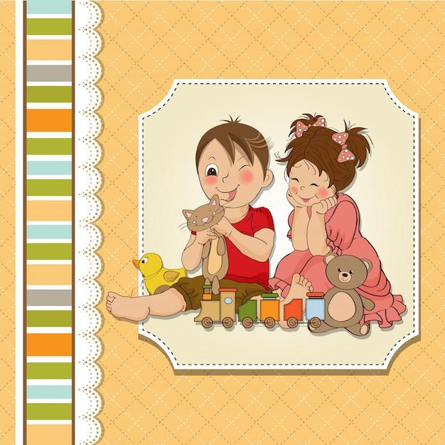 少女と少年がおもちゃで遊ぶ