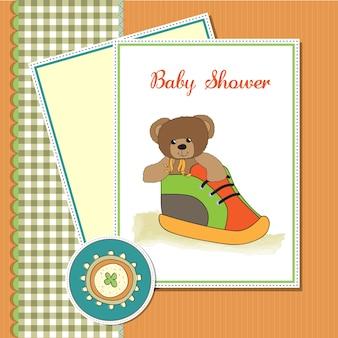 Душевая карточка с плюшевым медведем, скрытая в обуви