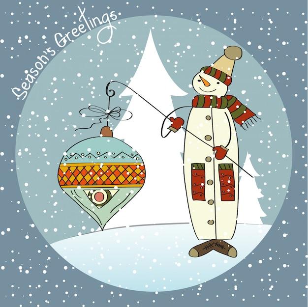 大きなクリスマスボールを持つ雪だるま