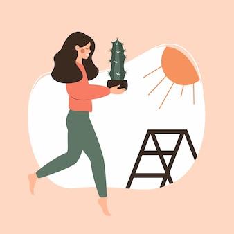日光に植物を運ぶ若い女性