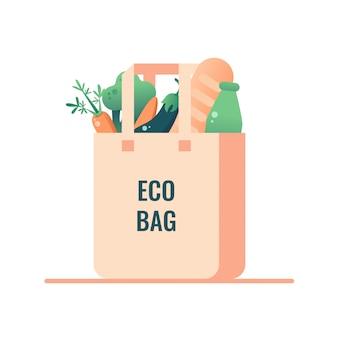 白い背景から分離されたビーガンフード付きの再利用可能な食料品エコバッグ。プラスチックにノーと言う