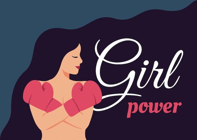 若い女性の女の子の力の概念は、ボクシンググローブで彼女の胸に彼女の腕を渡った。