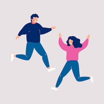 Пара счастливых людей, прыжки с поднятыми руками на свет.