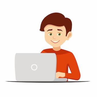 コンピューターで作業して幸せな少年
