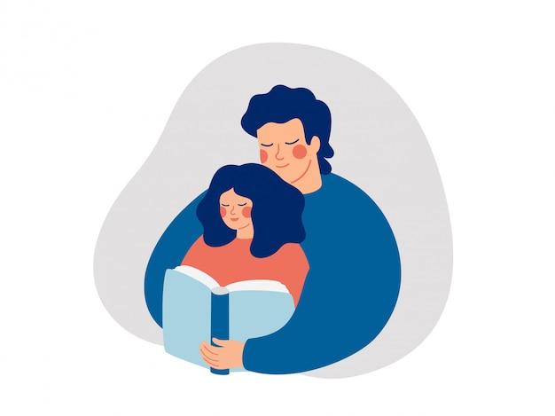 若い父親は娘に読むことを教えています。彼の子供と本を読んで幸せな男性親。
