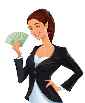 お金のスタックを持つ女性