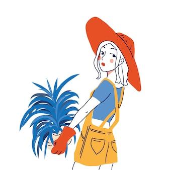Милая девушка с растением