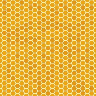 オレンジ色のハニカムのシームレスパターン