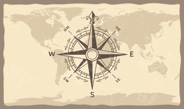 世界地図上のアンティークコンパス