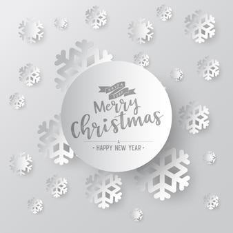 メリークリスマスフェーズテキストと白の華やかな背景にホワイトペーパースノーフレーク