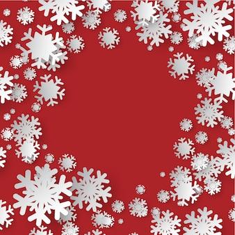 赤い色の華やかな背景にスノーフレークの色紙カット