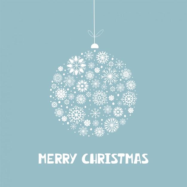 青の背景にメリークリスマスをレタリングとホワイトクリスマススノーフレークボール