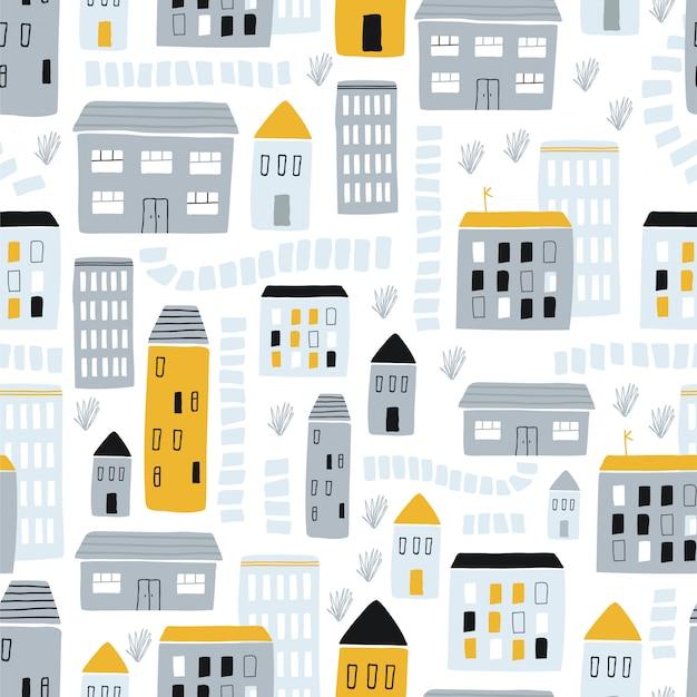 手描きでシームレスな幼稚なパターンは家の黄色と灰色の背景に灰色です。クリエイティブキッズシティ。図