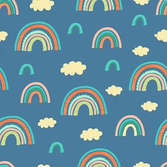 虹、雲と手の手紙とのシームレスなパターンは子供のために良いに焦点を当てる