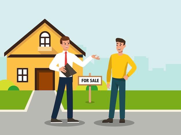 彼が買い手に売っている家を示す不動産業者