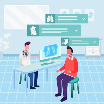 Доктор сидит за столом с компьютером и дает консультации пациенту
