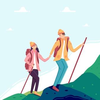 女と男のカップルが山でのハイキングします。