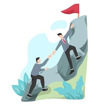 Лидер помогает команде взобраться на скалу и достичь цели