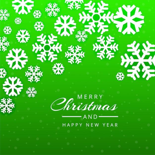 メリークリスマスグリーティングカード緑の雪片の背景