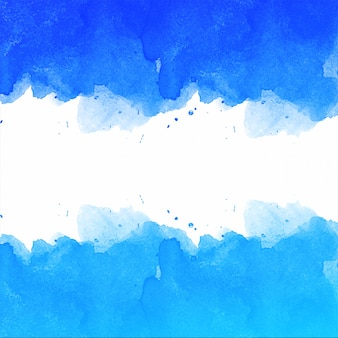 美しい手が青い水彩画背景を描く