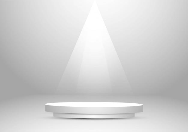 表彰台のスポットライトと灰色のスタジオの背景