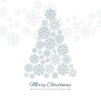 雪とクリスマスツリーとカード
