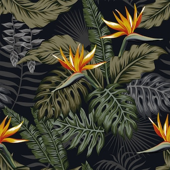 夜の熱帯のシームレスなパターンの植物と花