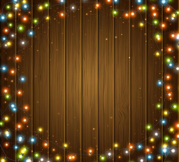 電球の背景の輝く花輪