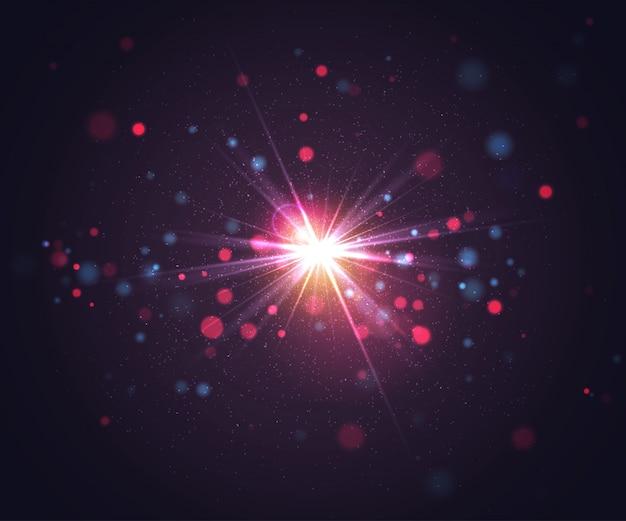 光とキラキラ粒子のフラッシュ。抽象的な背景