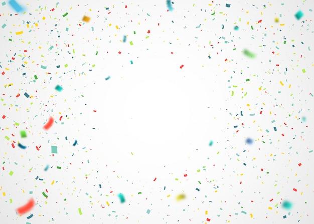 ランダムに飛んでいるカラフルな紙吹雪。爆発粒子と抽象的な背景