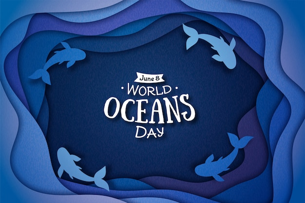 世界海洋デーのペーパーアート。海の波と魚